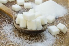 White sugar in wood spoon on wooden table. stock photography