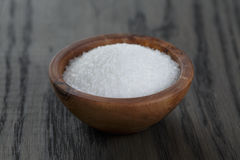 White sugar in wooden bowl for cooking or spa Stock Image