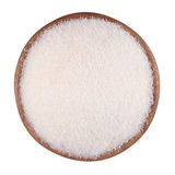 White sugar in a wooden bowl on a white Stock Images
