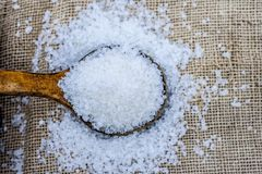 White sugar in wooden scoop.Sugar is the generic name for sweet, soluble Royalty Free Stock Image