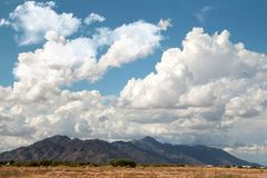 White Summer Clouds in the Desert Sky Royalty Free Stock Image