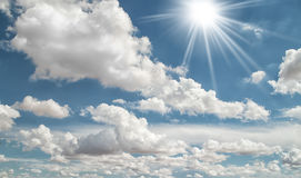 Summer Sun and White Clouds in the Sky. Blue summer skies with sunshine and clouds Royalty Free Stock Images