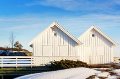 White summer cottage, windows with boards before the storm Royalty Free Stock Images