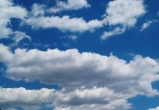 White summer cotton skies. Beautiful, white, cloudy summer sky that looks like cotton stock photos