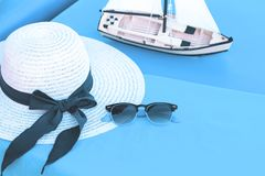 White summer hat with sunglasses at seaside stock photo