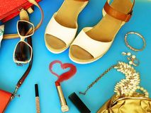 Women Accessories summer white sandals Ring Earring red handbag hat white sandals wallet fashion pi. White summer sandals White pearl,red purse,red bag, Women stock images