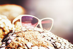 White sun glasses on the coast Royalty Free Stock Photos