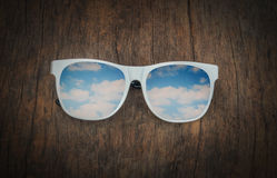 White  sun  glasses   on  old wood   background Stock Photo