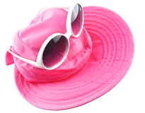 White sun glasses put on pink hat isolated Stock Image