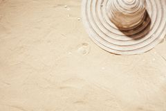 White sun hat on the sand. royalty free stock images