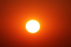 White sun in a red sky. Orange sky around the sun Royalty Free Stock Images