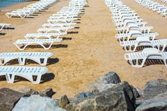 White sunbed on the sand beach at the sea, summer sea rest concept.  Royalty Free Stock Image