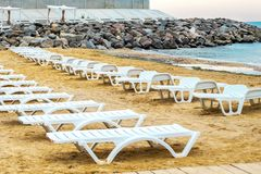 White sunbed on the sand beach at the sea, summer sea rest concept.  Stock Photography