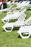 White sunbeds in a green garden Stock Photo