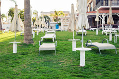 White sunbeds in Hotel`s garden. Summer holiday, hotel and spa concept.  Stock Photography