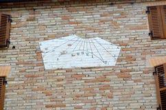 White sundial on a house wall Royalty Free Stock Photos