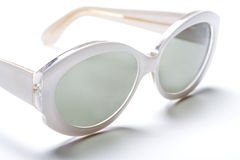 White Sunglasses. Photographs of white sunglasses on a white backgound royalty free stock photos