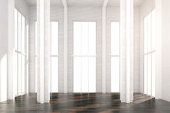White sunny loft room with brown wooden floor. Close up Royalty Free Stock Image