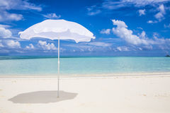 White sunshade  at the beach Stock Photo