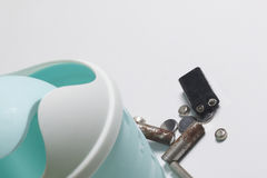 On the white surface is a plastic garbage can. Next to it lie the used batteries. View from above. Disposal of environmentally haz Royalty Free Stock Image