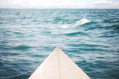 White surfboard on the sea, Royalty Free Stock Photography