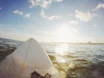 White Surfboard on Water Under Blue Sky Royalty Free Stock Photos