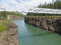 White suspension bridge across Miles Canyon Yukon Stock Images