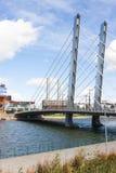 White suspension bridge over a river Royalty Free Stock Photo