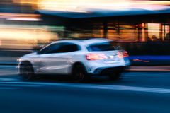 White. SUV Car in a Blurred City Scene Royalty Free Stock Images