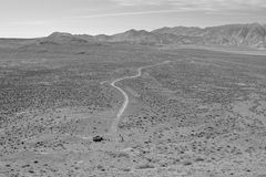 White SUV in the Desert (Black and White) Royalty Free Stock Photos