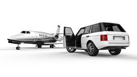 White SUV limousine with a private jet Royalty Free Stock Photo