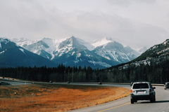 White Suv on Road Near Other Car during Daytime Royalty Free Stock Photo