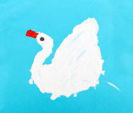 White swan on a blue background Royalty Free Stock Images
