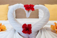 White swans made from towels on bed Royalty Free Stock Images
