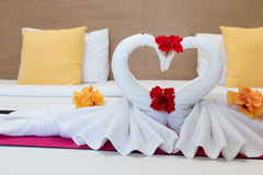 White swans made from towels on bed Royalty Free Stock Photo