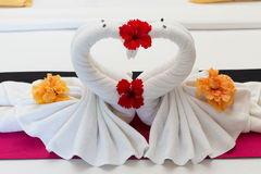 White swans made from towels on bed Royalty Free Stock Image