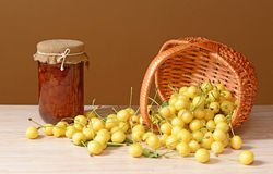 White sweet cherries spilled from a woven basket Stock Photo