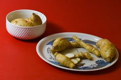 White sweet potato pieces slices protein food on red background royalty free stock photos