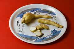 White sweet potato pieces slices protein food on red background stock photos