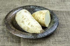 White sweet potatoes on a stone plate .Healthy nutrition concept.  royalty free stock photos