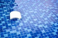 White swim board in swimming pool Stock Photo