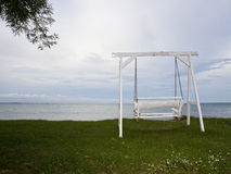 White swing on beach. And blue sky Stock Photography