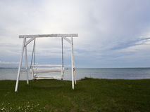 White swing on beach Royalty Free Stock Photos