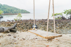 White swing on beach. White swing on a beach Stock Image