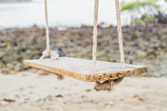 White swing on beach. White swing on a beach Stock Images