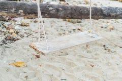 White swing on beach Stock Photos