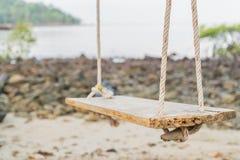 White swing on beach Stock Photo