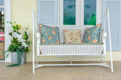 White swing bench with pillow Royalty Free Stock Images