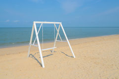 White swing. On the sand beach Royalty Free Stock Images