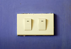 White switch on blue wall Stock Photography